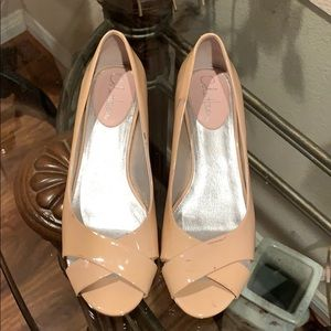 Cole Haan nude peep toe shoes.